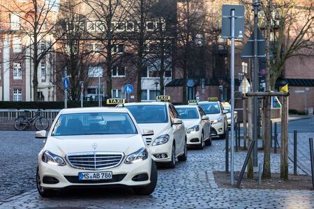 autos: MUNSTER, GERMANY- APR 4: Mercedes Benz E-Class Taxi Cabs at taxi rank in Muster. April 4, 2015 in Munster, Germany