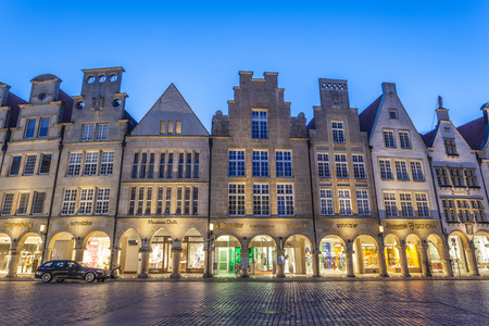 gabled houses: MUNSTER, GERMANY- APR 4: Gabled houses on the Prinzipalmarkt in the old town of Muenster. April 4, 2015 in Muenster, North Rhine-Westphalia, Germany