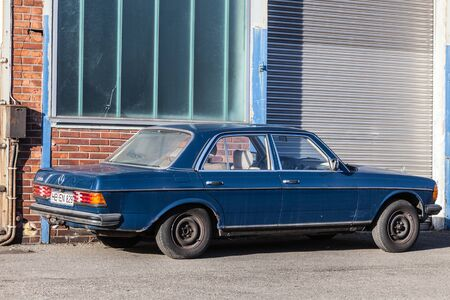 industrial park: BREMEN, GERMANY - APR 5: Old Mercedes Benz W123 parked in the industrial park in Bremen. April 5, 2015 in Bremen, Germany