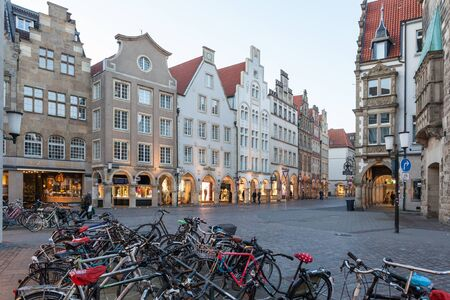gables: MUENSTER, GERMANY - APR 4: Bicycles in the old town of Muenster. Aprill 4, 2015 in Muenster, North Rhine Westphalia, Germany
