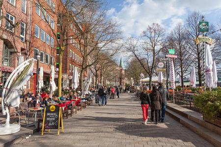 biergarten: BREMEN, GERMANY - APR 5: Waterfront promenade at the Weser river in Bremen. April 5, 2015 in Bremen, Germany
