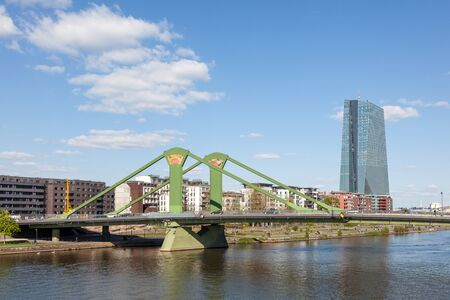 ecb: FRANKFURT MAIN, GERMANY - APR 18: Floesser bridge over river Main and the new European Central Bank (ECB) in Frankfurt. April 18, 2015 in Frankfurt Main, Germany