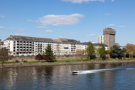 river main: FRANKFURT MAIN, GERMANY - APR 18: View over the River Main and residential waterfront buildings in Frankfurt. April 18, 2015 in Frankfurt Main, Germany