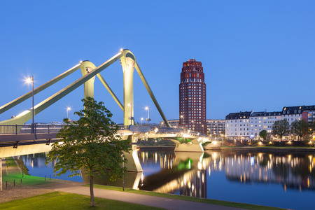 sachsenhausen: The old Floesser bridge illuminated at night in Frankfurt Main, Germany
