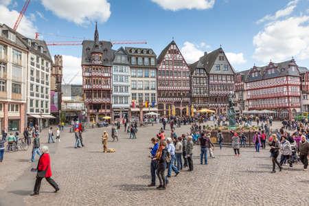 roemerberg: FRANKFURT, GERMANY - APR 18: People on Roemerberg square in the historic center of Frankfurt Main. April 18, 2015 in Frankfurt, Germany Editorial