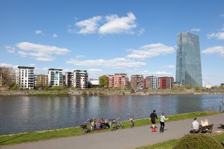ecb: FRANKFURT MAIN, GERMANY - APR 18: River Main and the new European Central Bank (ECB) building in Frankfurt. April 18, 2015 in Frankfurt Main, Germany Editorial