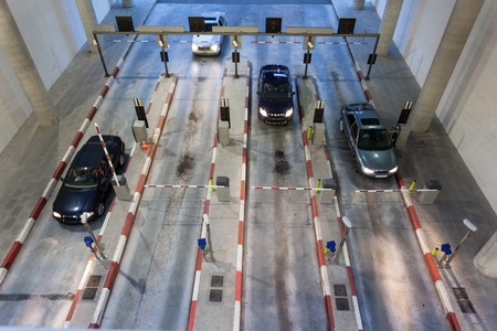 barrier: Cars entering a big parking garage