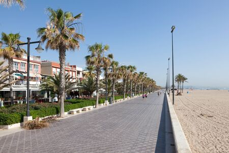 beachfront: VALENCIA, SPAIN - MAY 25: Beachfront promenade with date palm trees in Valencia. May 25, 2015 in Valencia, Spain Editorial