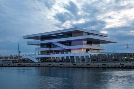 postmodern: VALENCIA, SPAIN - MAY 24: Americas Cup or (Veles e Vents) building in the port of Valencia illuminated at dusk. May 24, 2015 in Valencia, Spain