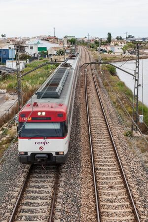 state owned: VALENCIA, SPAIN - MAY 24: Passenger train of the state owned company RENFE near Valencia. May 24, 2015 in Valencia, Spain Editorial