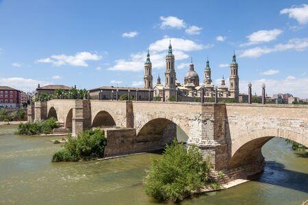 zaragoza: Medieval bridge and the Pillar Cathedral in Zaragoza, Aragon, Spain
