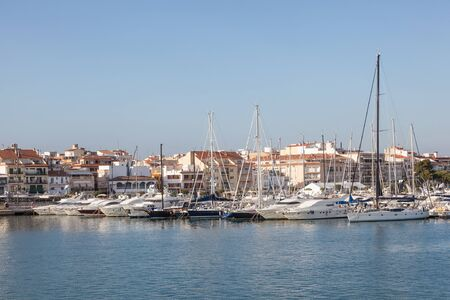 motorboats: Luxury yachts and motorboats at the marina in Cambrills, Catalonia, Spain Stock Photo