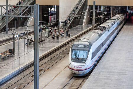 zaragoza: ZARAGOZA, SPAIN - MAY 26: Passenger train in Zaragoza Delicias - the main train station in Zaragoza. May 26, 2015 in Zaragoza, Spain Editorial