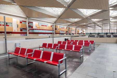 zaragoza: ZARAGOZA, SPAIN - MAY 26: Empty seats inside of Zaragoza Delicias - the main train station in Zaragoza. May 26, 2015 in Zaragoza, Spain