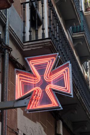 drug store: Red pharmacy sign or drug store symbol