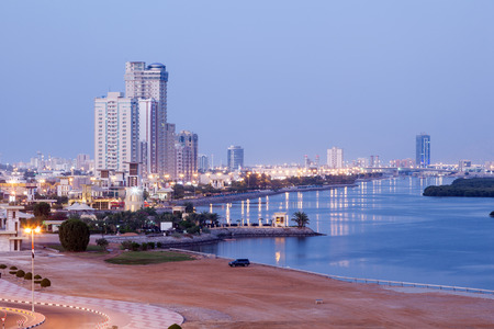Waterfront promenade at the creek in Ras al Khaimah at dusk, United Arab Emirates