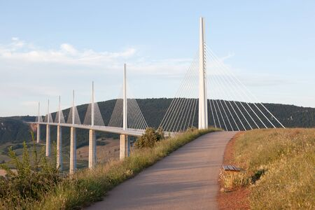 tallest bridge: MILLAU, FRANCE - MAY 28: The Millau Viaduct in France. The bridge is the tallest in the world with one masts summit at 343 meters. May 28, 2015 in Millau, France Editorial