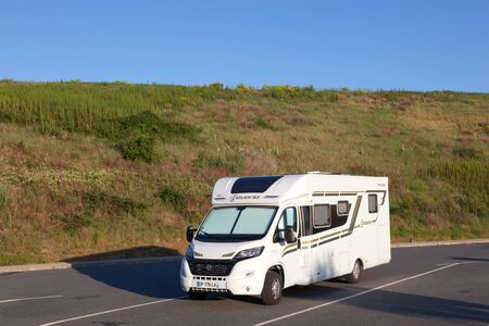 millau: MILLAU, FRANCE - MAY 28: Small european motorhome in a parking lot. May 28, 2015 in Millau, France Editorial