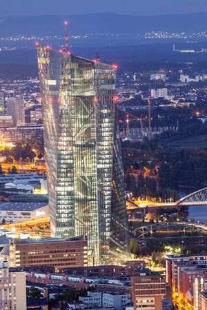 central european: FRANKFURT MAIN - JUNE 27: The European Central Bank skyscraper in the city of Frankfurt at night. June 27, 2015 in Frankfurt Main, Germany