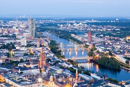 sachsenhausen: Aerial view over the city of Frankfurt Main illuminated at night. Hesse, Germany