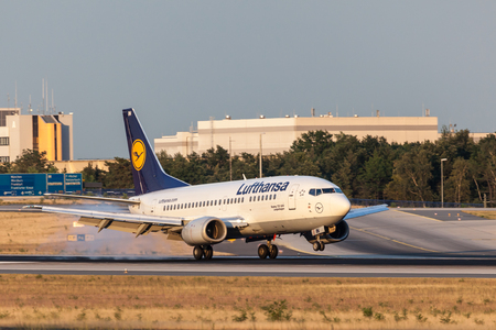 aircraft landing: FRANKFURT, GERMANY - JULY 18: Lufthansa Boeing 737-500 aircraft landing at the Frankfurt International Airport. July 18, 2015 in Frankfurt, Germany
