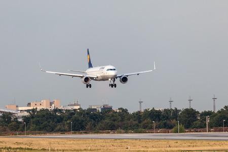 aircraft landing: FRANKFURT, GERMANY - JULY 18: Lufthansa Airbus A320-200 aircraft landing at the Frankfurt International Airport. July 18, 2015 in Frankfurt, Germany Editorial