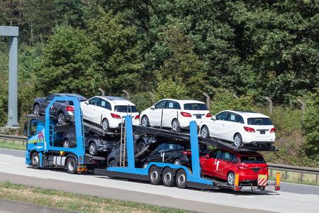 FRANKFURT, GERMANY - JULY 21: Car transporter truck moving at the A5 highway near Frankfurt in Germany. July 21, 2015 in Frankfurt Main, Germany Editorial