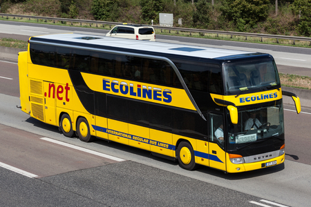 intercity: FRANKFURT, GERMANY - JULY 26: Intercity bus Ecolines moving fast on the highway A5 towards south. July 26, 2015 in Frankfurt Main, Germany