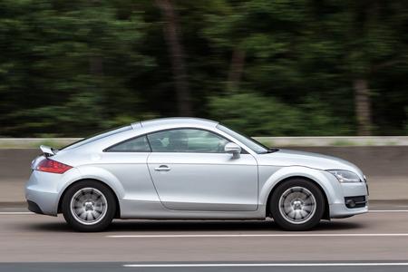 FRANKFURT, GERMANY - JULY 26: Audi TT Coupe moving fast on the highway A5 near Frankfurt. July 26, 2015 in Frankfurt Main, Germany Editorial