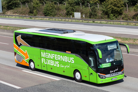 FRANKFURT, GERMANY - JULY 26: Intercity bus Meinfernbus Flixbus moving fast on the highway A5 towards south. July 26, 2015 in Frankfurt Main, Germany