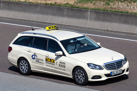 station wagon: FRANKFURT, GERMANY - JULY 26: Mercedes Benz W212 Station Wagon taxi moving fast on the highway A5 near Frankfurt. July 26, 2015 in Frankfurt Main, Germany
