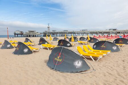 scheveningen: SCHEVENINGEN, NETHERLANDS - AUG 10: Windscreens and sunloungers on the beautiful North Sea beach in Scheveningen. August 10, 2015 in Scheveningen, The Netherlands