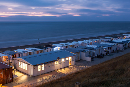 Seaside trailer park illuminated at dusk in Holland, Netherlands