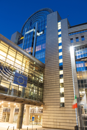 leopold: BRUSSELS, BELGIUM - AUG 21: European Parliament office buildings at the Espace Leopold (Leopold Square) illuminated at night. August 21, 2015 in Brussels, Belgium Editorial