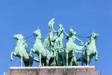 quadriga: Quadriga statue at the Triumphal Arch Arcade du Cinquantenaire in Brussels, Belgium Editorial