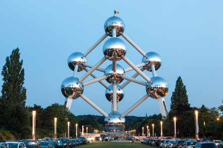 BRUSSELS, BELGIUM - AUG 22: The Atomium building at the World Fair grounds in Brussels illuminated at dusk. August 22, 2015 in Brussels, Belgium