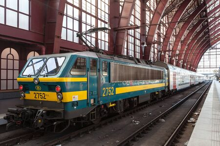 antwerp: ANTWERP, BELGIUM - AUG 23: Engine with wagons at the Main Railway Station in the city of Antwerp. August 23, 2015 in Antwerp, Belgium