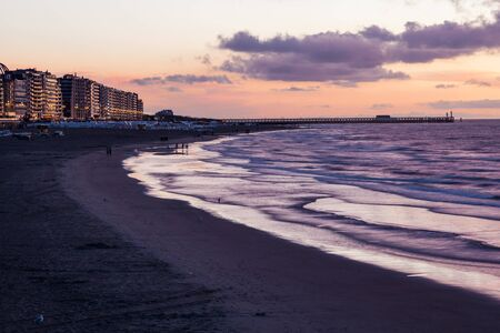 flanders: North Sea beach at sunset. Town Blankenberge, West Flanders, Belgium