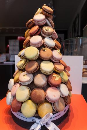 bruges: BRUGES, BELGIUM - AUG 23: Traditional belgian pastries in a shop window in Bruges. August 23, 2015 in Bruges, Belgium Editorial