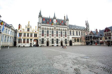 bruges: BRUGES, BELGIUM - AUG 23: The historic Great Market (Grote Markt) in the city of Bruges. August 23, 2015 in Bruges, Belgium