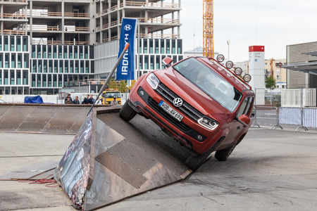 iaa: FRANKFURT, GERMANY - SEP 22: Volkswagen Amarok pickup truck driving at an offroad parcours at the IAA International Motor Show 2015. September 22, 2015 in Frankfurt Main, Germany Editorial