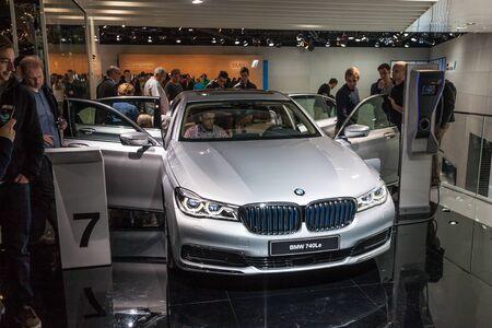 hybrid car: FRANKFURT, GERMANY - SEP 22: Visitors are watching the new BMW 740le hybrid car at the IAA International Motor Show 2015. September 22, 2015 in Frankfurt Main, Germany