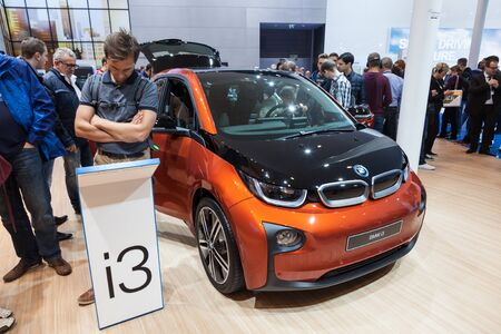 i3: FRANKFURT, GERMANY - SEP 22: The new BMW i3 electric car at the BMW booth of the IAA International Motor Show 2015. September 22, 2015 in Frankfurt Main, Germany