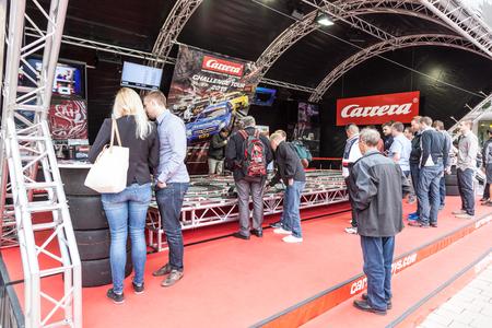 carrera: FRANKFURT, GERMANY - SEP 22: Carrera Slot Car Racing Racing Challenge booth at  the IAA International Motor Show 2015. September 22, 2015 in Frankfurt Main, Germany