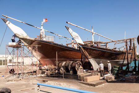 dockyard: MANAMA, BAHRAIN - NOV 14: Traditional dhow in the dockyard of Manama. November 14, 2015 in Manama, Kingdom of Bahrain