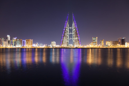 trade: Manama City skyline illuminated at  night. Kingdom of Bahrain, Middle East