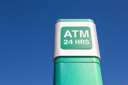 hrs: MANAMA, BAHRAIN - NOV 15: The 24 hrs ATM of the Kuwait Finance House bank in Manama city. November 15, 2015 in Manama, Kingdom of Bahrain