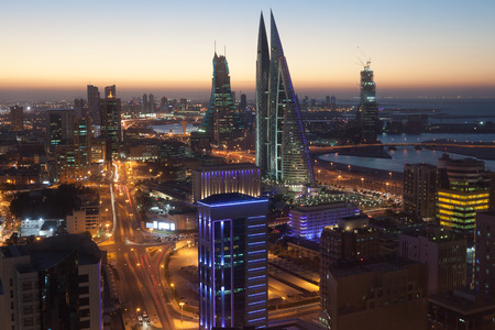 Manama City illuminated at night. Kingdom of Bahrain, Middle East