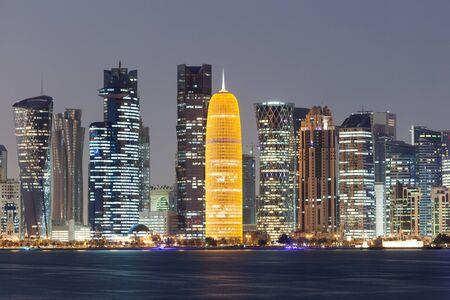 Doha city skyline illuminated at night. Qatar, Middle East Stock Photo