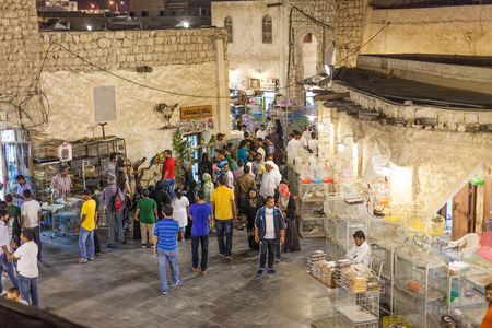 thoub: DOHA, QATAR - NOV 19: Qatari people shopping at the traditional market Souq Waqif. November 19, 2015 in Doha, Qatar, Middle East